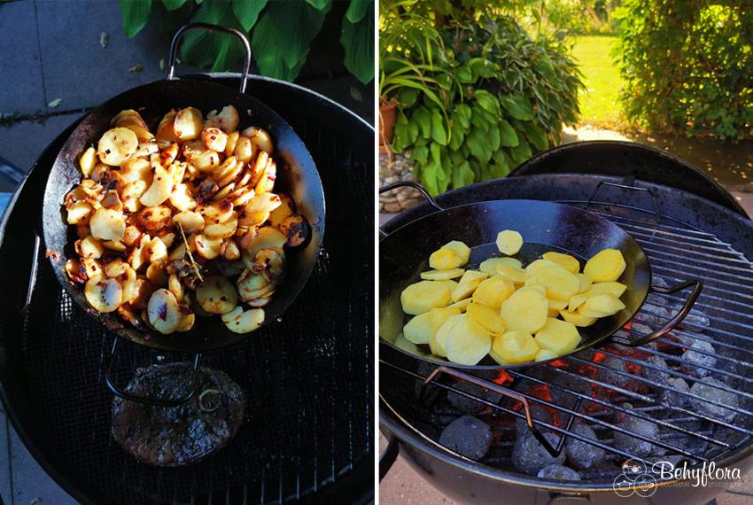Bratkartoffeln in der Eisenpfanne auf dem Grill